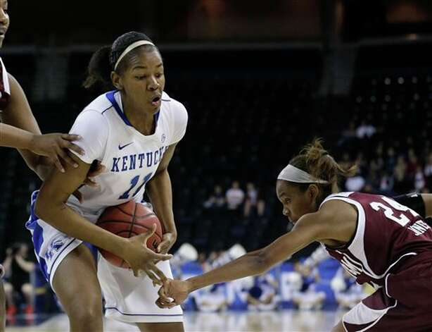 Kentucky center DeNesha Stallworth (11) and Texas A&M guard Jordan Jones (24) struggle for control of the ball during the first half of their  NCAA college basketball game in the finals of the Southeastern Conference tournament, Sunday, March 10, 2013, in Duluth, Ga.  (AP Photo/John Bazemore) Photo: John Bazemore, Associated Press / AP
