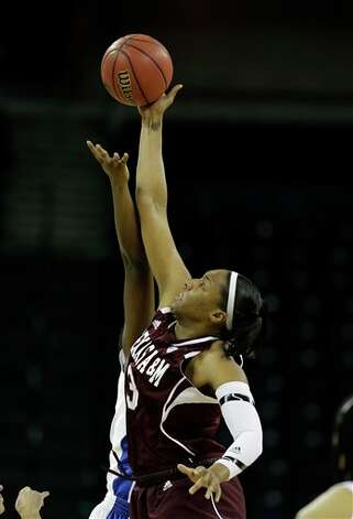 Texas A&M center Kelsey Bone (3) fights for the ball on the tip off during the first half of their  NCAA college basketball game against Kentucky in the finals of the Southeastern Conference tournament, Sunday, March 10, 2013, in Duluth, Ga.  (AP Photo/John Bazemore) Photo: John Bazemore, Associated Press / AP