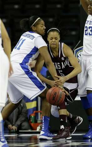 Texas A&M forward Kristi Bellock (5) and Kentucky center DeNesha Stallworth (11) fight for a lose ball during the first half of their  NCAA college basketball game in the finals of the Southeastern Conference tournament, Sunday, March 10, 2013, in Duluth, Ga.  (AP Photo/John Bazemore) Photo: John Bazemore, Associated Press / AP