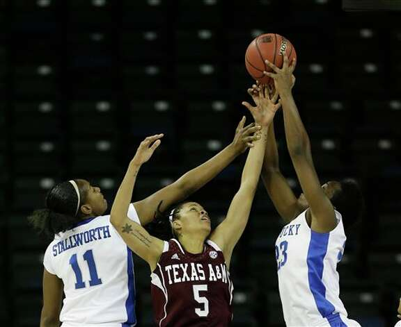Kentucky center DeNesha Stallworth (11) and Kentucky forward/center Samarie Walker (23) battle Texas A&M forward Kristi Bellock (5) for a rebound during the first half of their  NCAA college basketball game in the finals of the Southeastern Conference tournament, Sunday, March 10, 2013, in Duluth, Ga.  (AP Photo/John Bazemore) Photo: John Bazemore, Associated Press / AP