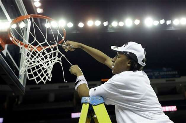 Texas A&M center Kelsey Bone (3) cuts down the net after defeating Kentucky  in an  NCAA college basketball game in the finals of the Southeastern Conference tournament, Sunday, March 10, 2013, in Duluth, Ga.  Texas A&M  won 75-67. (AP Photo/John Bazemore) Photo: John Bazemore, Associated Press / AP