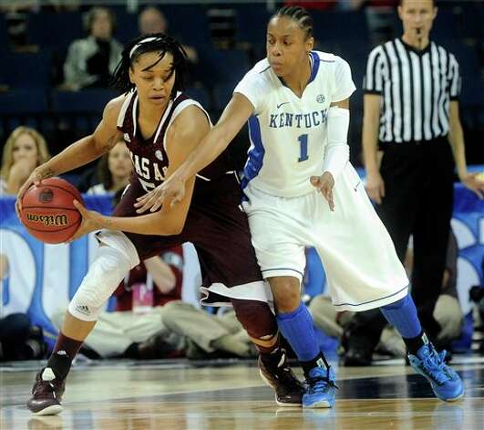 Texas A&M forward Kristi Bellock, left, tries to keep the ball away from Kentucky guard A'dia Mathies (1) during the second half of an NCAA college basketball game in the championship of the Southeastern Conference tournament, Sunday, March 10, 2013, in Duluth, Ga. Texas A&M won 75-67. (AP Photo/John Amis) Photo: John Amis, Associated Press / FR69715 AP