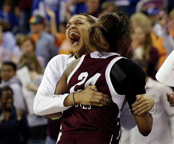 Texas A&M guard Curtyce Knox (11) and Jordan Jones (24) embrace during the second half of their  NCAA college basketball game against Kentucky in the finals of the Southeastern Conference tournament, Sunday, March 10, 2013, in Duluth, Ga.  Texas A&M  won 75-67. (AP Photo/John Bazemore) Photo: John Bazemore, Associated Press / AP