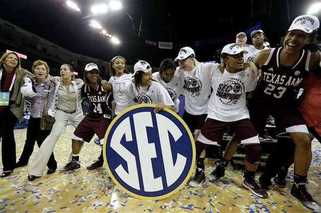 Texas A&M  players and staff celebrate after defeating Kentucky in an  NCAA college basketball game in the championship of the Southeastern Conference tournament, Sunday, March 10, 2013, in Duluth, Ga.  Texas A&M  won 75-67. (AP Photo/John Bazemore) Photo: John Bazemore, Associated Press / AP