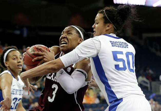 Texas A&M center Kelsey Bone (3) drives through the lane as Kentucky forward/center Azia Bishop (50) defends during the second half of an NCAA college basketball game in the championship of the Southeastern Conference tournament, Sunday, March 10, 2013, in Duluth, Ga. Texas A&M  won 75-67. (AP Photo/John Bazemore) Photo: John Bazemore, Associated Press / AP