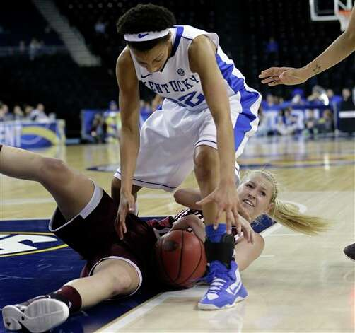 Texas A&M guard Peyton Little (20) and Kentucky guard Kastine Evans (32) scramble for a loose ball during the second half of an NCAA college basketball game in the championship of the Southeastern Conference tournament, Sunday, March 10, 2013, in Duluth, Ga.  Texas A&M  won 75-67. (AP Photo/John Bazemore) Photo: John Bazemore, Associated Press / AP