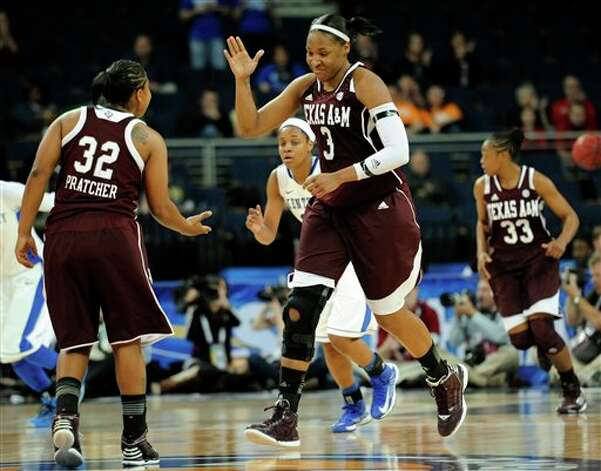 Texas A&M center Kelsey Bone (3) celebrates with guard Adrienne Pratcher (32) after scoring against Kentucky during the second half of an NCAA college basketball game in the championship of the Southeastern Conference tournament, Sunday, March 10, 2013, in Duluth, Ga. Texas A&M won 75-67. (AP Photo/John Amis) Photo: John Amis, Associated Press / FR69715 AP