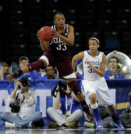 Texas A&M guard Courtney Walker (33) pulls down a rebound in front of Kentucky guard Kastine Evans (32) during the second half of an NCAA college basketball game in the championship of the Southeastern Conference tournament, Sunday, March 10, 2013, in Duluth, Ga.  Texas A&M  won 75-67. (AP Photo/John Bazemore) Photo: John Bazemore, Associated Press / AP