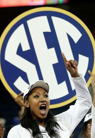 Texas A&M center Karla Gilbert (34) celebrates after defeating Kentucky  75-67 in an  NCAA college basketball game in the championship of the Southeastern Conference tournament, Sunday, March 10, 2013, in Duluth, Ga.  (AP Photo/John Bazemore) Photo: John Bazemore, Associated Press / AP