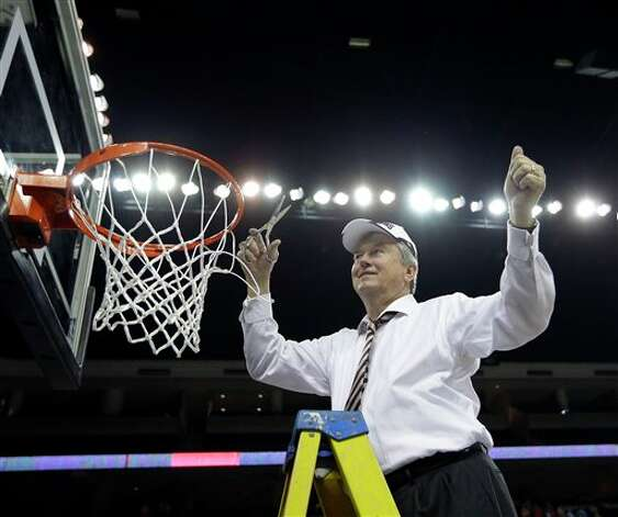 Texas A&M  coach Gary Blair cuts down the net after defeating Kentucky  75-67 in an NCAA college basketball game in the championship of the Southeastern Conference tournament, Sunday, March 10, 2013, in Duluth, Ga.   (AP Photo/John Bazemore) Photo: John Bazemore, Associated Press / AP