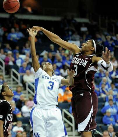 Texas A&M center Kelsey Bone (3) blocks a shot by Kentucky guard Janee Thompson (3) during the second half of an NCAA college basketball game in the championship of the Southeastern Conference tournament, Sunday, March 10, 2013, in Duluth, Ga. Texas A&M won 75-67. (AP Photo/John Amis) Photo: John Amis, Associated Press / FR69715 AP