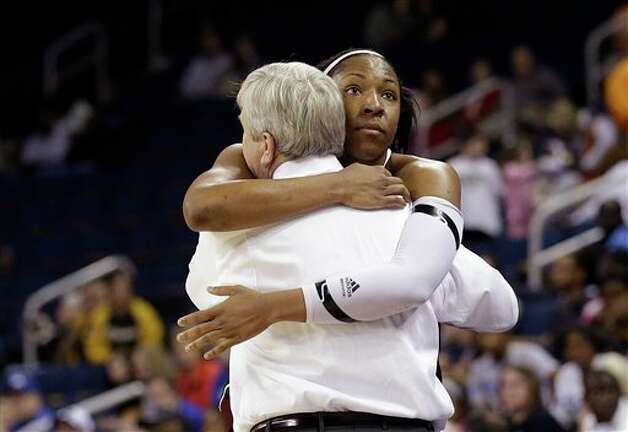 Texas A&M center Kelsey Bone (3) hugs coach Gary Blair in the final seconds of their  NCAA college basketball game against Kentucky in the finals of the Southeastern Conference tournament, Sunday, March 10, 2013, in Duluth, Ga.  Texas A&M  won 75-67. (AP Photo/John Bazemore) Photo: John Bazemore, Associated Press / AP