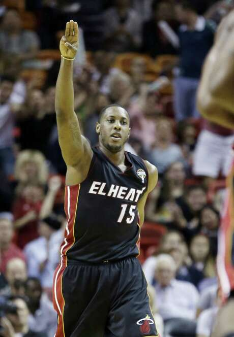 Mario Chalmers led the way with 26 points on 7-of-9 shooting as the Heat won their 18th in a row. The Miami point guard became only the second player since November 2010 to score at least 26 points while taking nine or less shots. Photo: Alan Diaz / Associated Press
