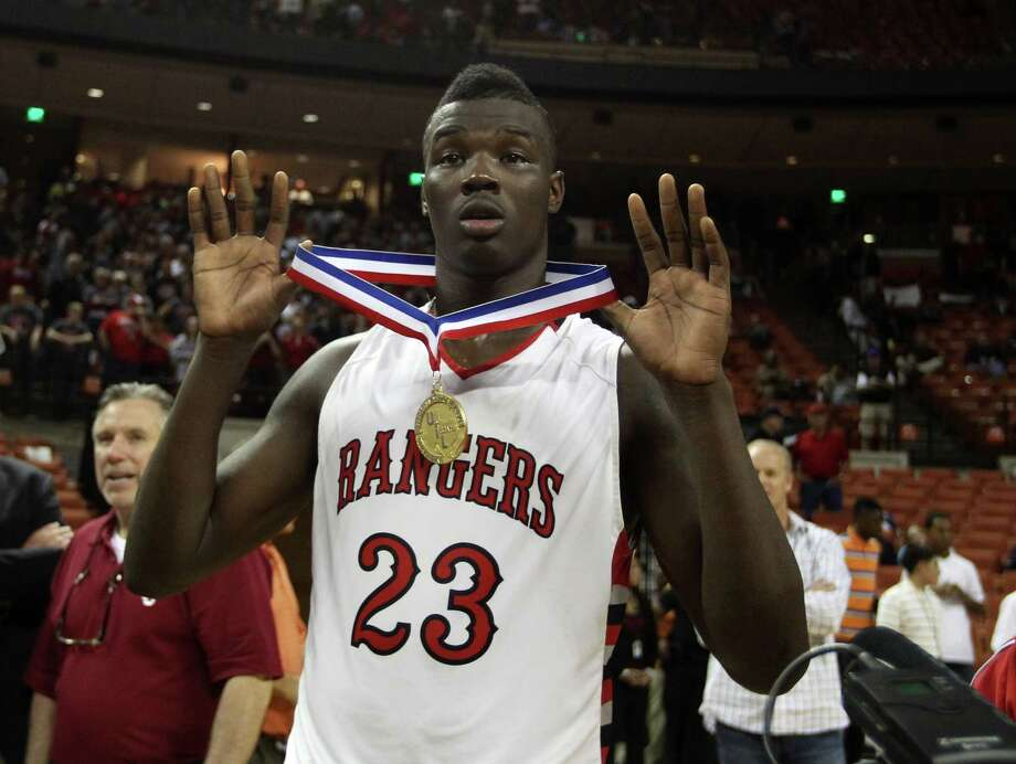 Rosenberg Terry's Derrick Griffin (23) celebrates with his teammates after their win over Dallas Kimball in the UIL 4A boys state basketball final game at the Frank Erwin Center, Saturday, March 9, 2013, in Austin.  Terry won the game 55-47. ( Karen Warren / Houston Chronicle ) Photo: Karen Warren, Staff / © 2013 Houston Chronicle