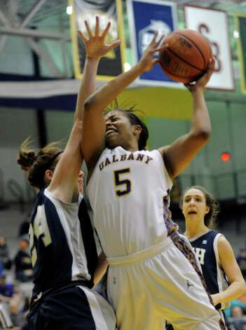 UAlbany's Ebone Henry (5) is defended by UNH's Cari Reed (24) during the semifinal game of the America East tournament in Albany, N.Y., Sunday, March 10, 2013. UAlbany won 71-57. (Hans Pennink / Special to the Times Union) College Sports Photo: Hans Pennink / Hans Pennink