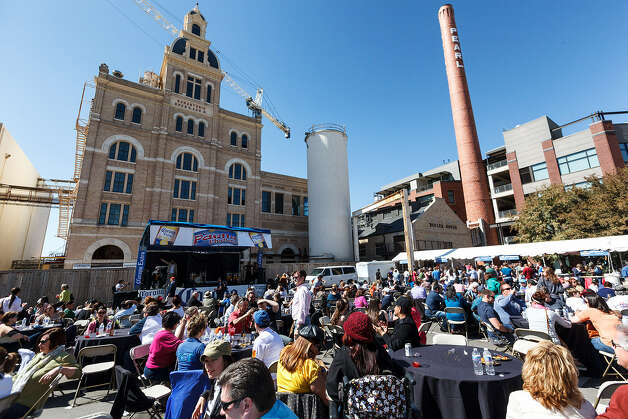 The crowd enjoys their paella and music on the grounds of the Pearl Brewery. Photo: Marvin Pfeiffer / San Antonio Express-News