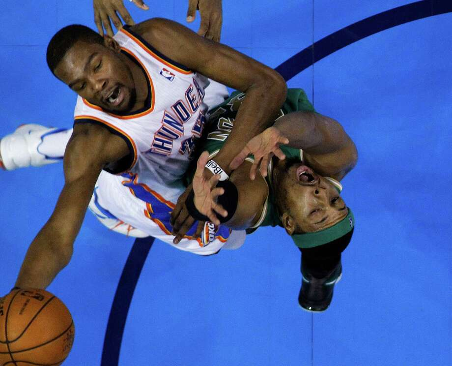 Oklahoma City Thunder forward Kevin Durant, left, shoots over Boston Celtics forward Paul Pierce (34) in the first quarter of an NBA basketball game in Oklahoma City  Sunday  March 10, 2013. Oklahoma City won 91-79 (AP Photo/Sue Ogrocki) Photo: Sue Ogrocki