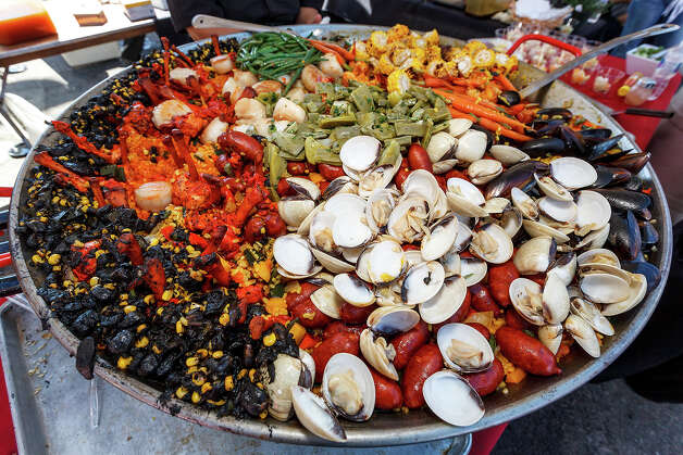 A tray of paella prepared by Chef Flor Vergara of True Flavors Culinary Planners during the 4th Annual Corona Paella Challenge, hosted by La Gloria chef, Johnny Hernandez, on the grounds of the Pearl Brewery on Sunday, March 10, 2013.  Twenty-five of the top chefs in this country and throughout Latin America competed in the event as well as five area high schools. Photo: Marvin Pfeiffer / San Antonio Express-News / Express-News 2013