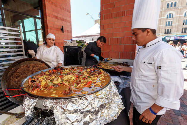 Chef Jhojans Priego Zarate from Veracruz, Mexico (right) works on his paella dish during the 4th Annual Corona Paella Challenge, hosted by La Gloria chef, Johnny Hernandez, on the grounds of the Pearl Brewery on Sunday, March 10, 2013.  Twenty-five of the top chefs in this country and throughout Latin America competed in the event as well as five area high schools. Photo: Marvin Pfeiffer / San Antonio Express-News / Express-News 2013