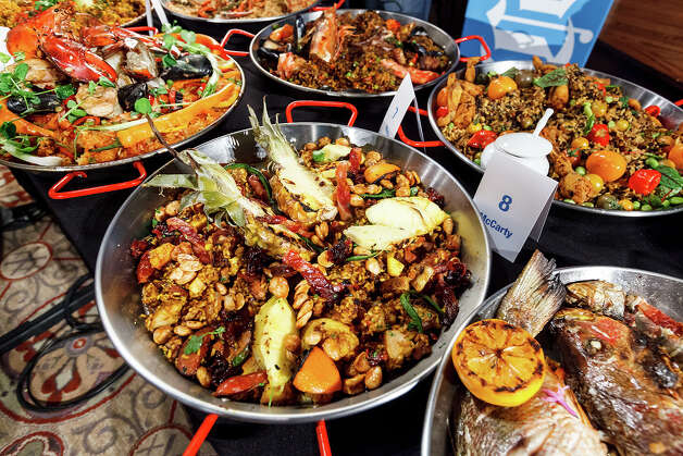 Entries in the contemporary paella division during the 4th Annual Corona Paella Challenge, hosted by La Gloria chef, Johnny Hernandez, on the grounds of the Pearl Brewery on Sunday, March 10, 2013.  Twenty-five of the top chefs in this country and throughout Latin America competed in the event as well as five area high schools. Photo: Marvin Pfeiffer / San Antonio Express-News / Express-News 2013