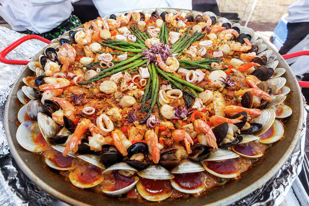A paella dish prepared by Sam Houston High School Culinary Arts during the 4th Annual Corona Paella Challenge, hosted by La Gloria chef, Johnny Hernandez, on the grounds of the Pearl Brewery on Sunday, March 10, 2013.  Twenty-five of the top chefs in this country and throughout Latin America competed in the event as well as five area high schools. Photo: Marvin Pfeiffer / San Antonio Express-News / Express-News 2013