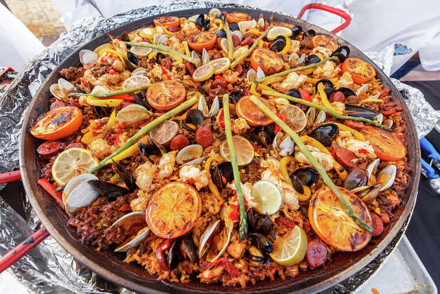 A paella dish prepared by Theodore Roosevelt High School Culinary Arts during the 4th Annual Corona Paella Challenge, hosted by La Gloria chef, Johnny Hernandez, on the grounds of the Pearl Brewery on Sunday, March 10, 2013.  Twenty-five of the top chefs in this country and throughout Latin America competed in the event as well as five area high schools. Photo: Marvin Pfeiffer / San Antonio Express-News / Express-News 2013