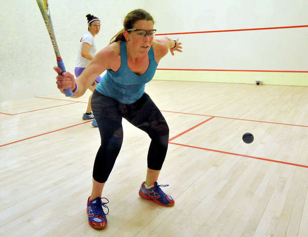 Greenwich resident Natalie Grainger, in teal, competes against Amanda Sobhy, in white shirt, for the U.S. Womens Squash Championships at Chelsea Piers in Stamford on Sunday, March 10, 2013. Photo: Jason Rearick / The Advocate