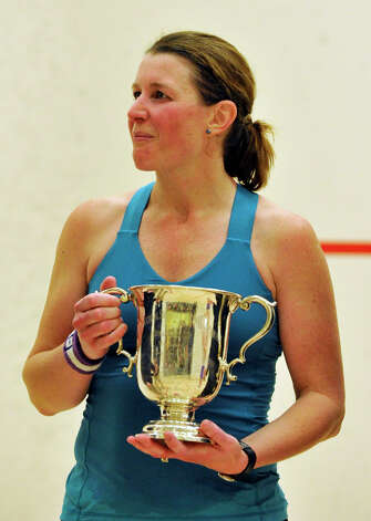 Greenwich resident Natalie Grainger, in teal, celebrates her win over Amanda Sobhy during the finals of the U.S. Womens Squash Championships at Chelsea Piers in Stamford on Sunday, March 10, 2013. Photo: Jason Rearick / The Advocate