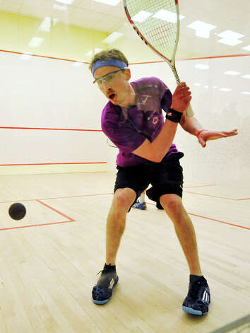 Gilly Lane, in black, from Wyndmoor, Pa., competes against Christopher Gordon, in a purple t-shirt, of Long Island City, N.Y., for the U.S. Mens Squash Championship title at Chelsea Piers in Stamford on Sunday, March 10, 2013. Photo: Jason Rearick / The Advocate