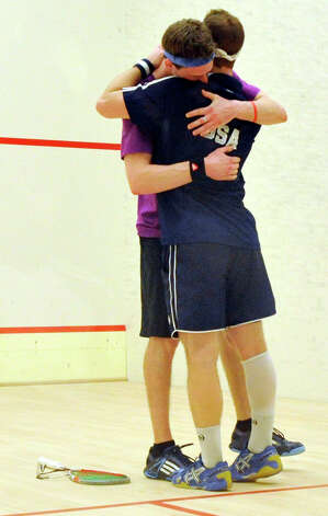 Christopher Gordon, in a purple t-shirt, of Long Island City, N.Y., hugs Gilly Lane, of Wyndmoor, Pa., after Gordon won the U.S. Mens Squash Championship title at Chelsea Piers in Stamford on Sunday, March 10, 2013. Photo: Jason Rearick / The Advocate
