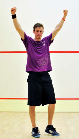 Christopher Gordon, in a purple t-shirt, of Long Island City, N.Y., celebrates his win over Gilly Lane, of Wyndmoor, Pa., for the U.S. Mens Squash Championship title at Chelsea Piers in Stamford on Sunday, March 10, 2013. Photo: Jason Rearick / The Advocate