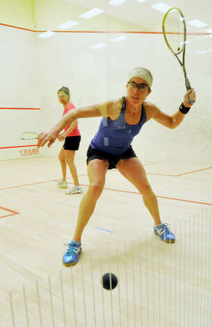 Juliana Lilien, of Brooklyn, N.Y., in blue, competes against Shabana Khan, of Seattle, Wash., in pink, during the finals of the U.S. Masters 40+ Womens Squash Championships at Chelsea Piers in Stamford on Sunday, March 10, 2013. Photo: Jason Rearick / The Advocate