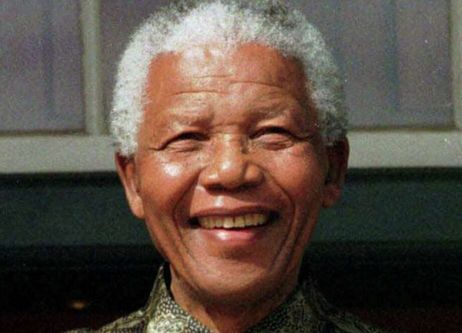"""FILE - In this May 11, 1999 file photo, South African President Nelson Mandela, is photographed in Cape Town, South Africa. Mandela, the former South African president and anti-apartheid leader, was admitted to a hospital on Saturday, March 9, 2013, for a scheduled medical check-up and doctors say there is no cause for """"alarm,"""" the president's office said.  (AP Photo, File) Photo: Uncredited, STR / AP"""