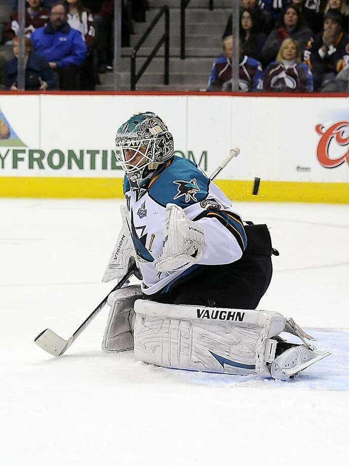 The puck gets past Sharks goalie Antti Niemi for the game- winning goal by Avalanche center Matt Duchene in the last second of overtime. Photo: Chris Schneider, Associated Press