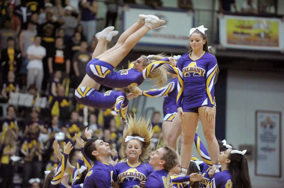 UAlbany cheer leaders perform during a time out at the UAlbany Stony Brook game at the SEFCU Arena on Sunday, March 10, 2013 in Albany, NY.  (Paul Buckowski / Times Union) Photo: Paul Buckowski