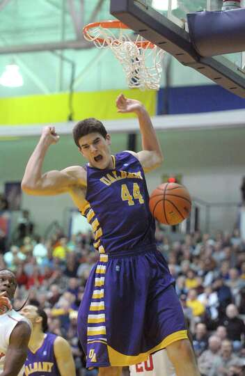 John Puk of UAlbany celebrates after dunking on offensive rebound in their game against Stony Brook