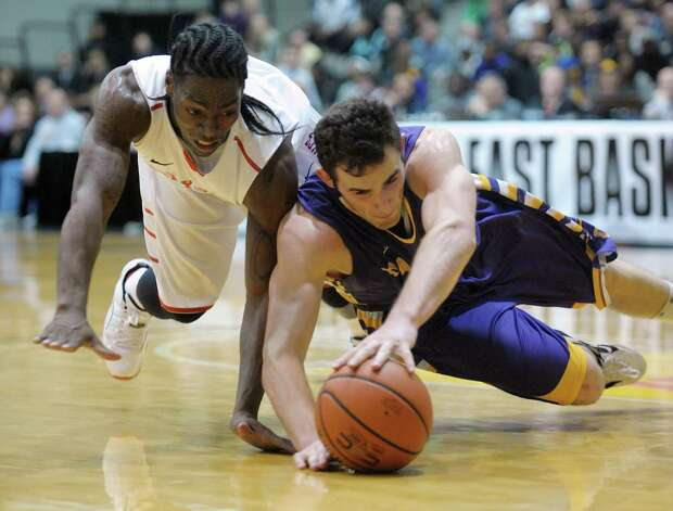 Sam Rowley of UAlbany, right, dives for the ball as Dave Coley of Stony Brook does the same  during their game at the SEFCU Arena on Sunday, March 10, 2013 in Albany, NY.  (Paul Buckowski / Times Union) Photo: Paul Buckowski