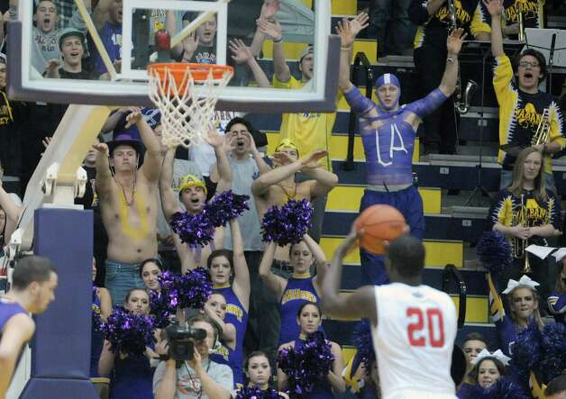 UAlbany fans yell to distract Jameel Warney of Stony Brook as he tries to shoot a free throw during their game at the SEFCU Arena on Sunday, March 10, 2013 in Albany, NY.  (Paul Buckowski / Times Union) Photo: Paul Buckowski