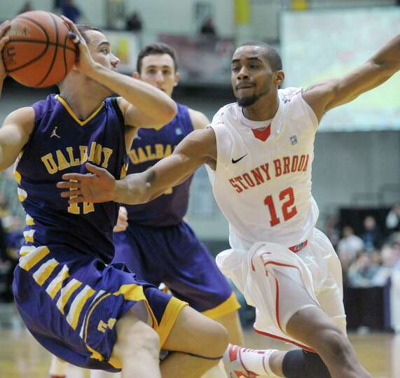 Peter Hooley of UAlbany, left, tries to get around Marcus Rouse of Stony Brook during their game at