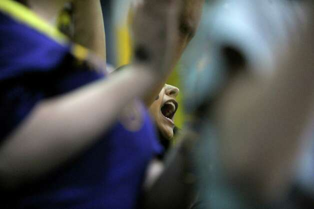 A UAlbany fan cheers on her team in their game against Stony Brook at the SEFCU Arena on Sunday, March 10, 2013 in Albany, NY.  (Paul Buckowski / Times Union) Photo: Paul Buckowski