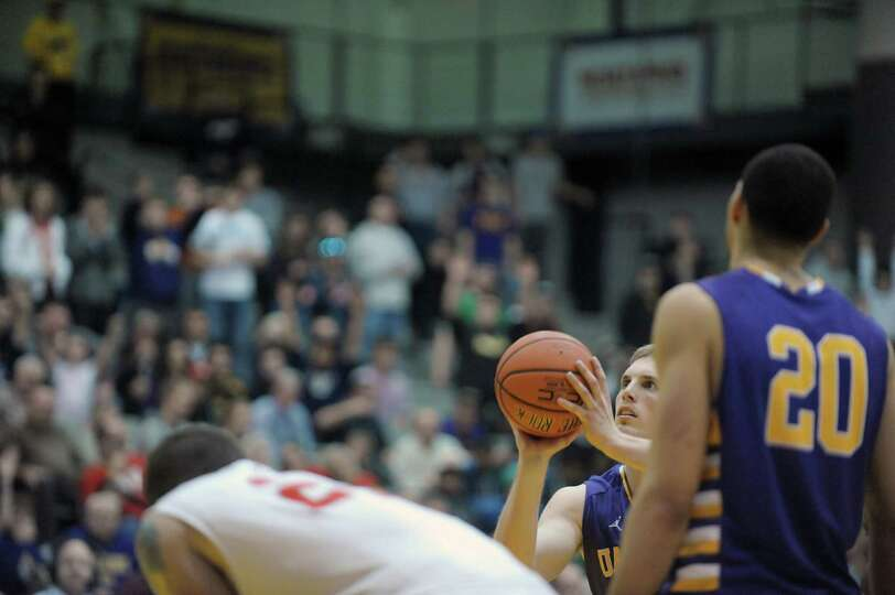 Luke Devlin of UAlbany shoots a free throw late in their game against Stony Brook at the SEFCU Arena