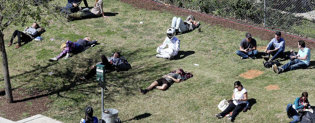 People relax near the Austin Convention Center during South by Southwest Sunday March 10, 2013 in Austin, TX. Photo: Edward A. Ornelas, San Antonio Express-News / © 2013 San Antonio Express-News