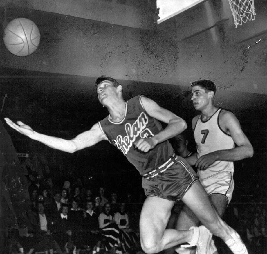 "The caption for this March 1954 photo read: ""Chelan's Roy Ross (No. 3) tries in vain to keep the ball inbounds in the Chelan-Zillah State Class B basketball tourney game at Tacoma Thursday. Number 7 is Mike Katsoras of Zillah. Zillah won 75-71."" Photo: Seattlepi.com File"