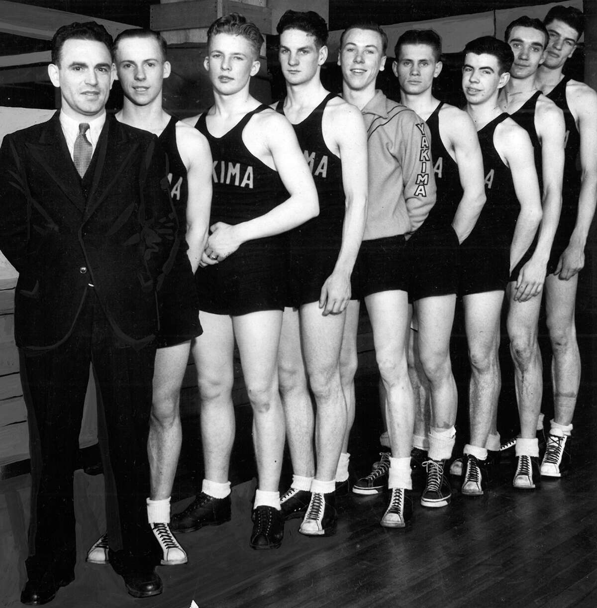 This March 1935 photo shows the Yakima basketball team that beat Prescott. Left to right are Coach Art Cheyne, Bryant Russell, Don Dwinnell, John Crim, Kenneth Warren, Cassius Dolquist, Bill Sherman, Albert Rooney, and Art Berg. Berg and Dolquist were selected all-tournament players.