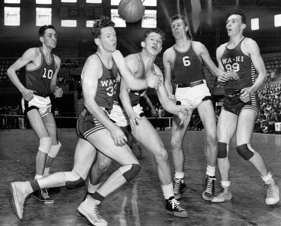 "The caption for this March 1949 photo read: ""There were thrills and heartaches aplenty yesterday at Edmundson Pavillion as the opening games in the state high school basketball tourbnament got under way. Here is an action scene in the Longview-Walla Walla thriller, which was won by Longview. Left to right are Warren Morris, Longview (10); Larry Morrison, Walla Walla (33); Bill Millette, Longview (11); Phil Brown, Longview (6), and Terry Lynch, Walla Walla (99)."" Photo: Stuart Hertz/seattlepi.com File"