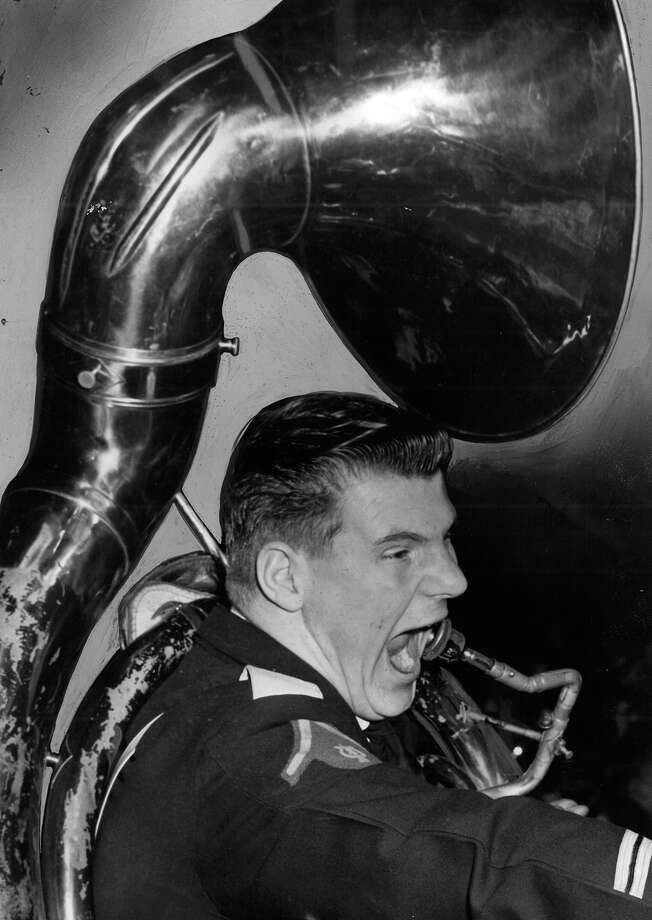 "The caption for this March 1954 photo read: ""Louis Nelson, who toots for the Sousaphone in the Highline band, still has enough wind to sound off for the Pirates as they defeat Wapato in the quarter-finals."" Photo: John ""Hack"" Miller/seattlepi.com File"