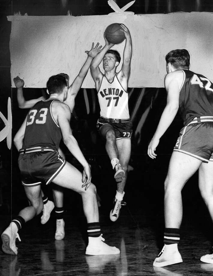 "The caption for this March 12, 1953 photo read: ""Spiral Bosley of Renton goes up for a two-pointer to aid the Indians 60-37 defeat of Cleveland in the prep cage meet at Hec Edmundson Pavilion Thursday night. Trying to defend against Bosley is Dan Niksich (33) and Dick Stuns (42). The Indians advanced into the semi-final round and will play Elma Friday night."" Photo: Watton/seattlepi.com File"