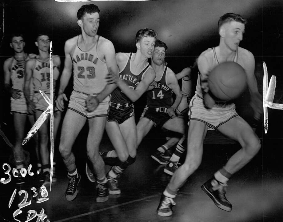 "This photo caption from March 1951 read: ""Chuck Rabung, of Yakima, speeds off downcourt as Seattle Prep's John Haberle and Joe Quinn (14) attempt to overtake him. Yakima's Frank McBarron (23) looks on."" Photo: Ed Watton/seattlepi.com File"