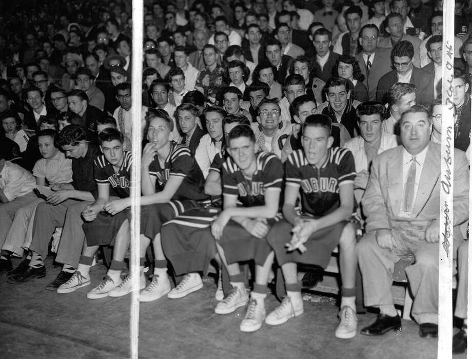 "This March 1954 photo caption read: ""Auburn's bench gives the team vocal support. The Trojans from the Puget Sound Conference defeated Wapato, 58-52, in overtime Friday to assure themselves a place among the top eight teams in the basketball tourney at Edmundson Pavilion."" (Marks were made by a P-I photo editor.) Photo: John ""Hack"" Miller/seattlepi.com"
