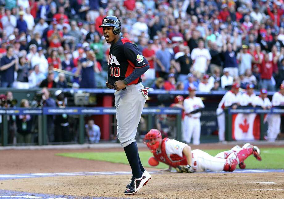 Former Missions player Adam Jones scores a run during the eighth inning of the United States' 9-4 win over Canada. The Americans scored eight runs in the last two innings to pull away. Photo: Christian Petersen / Getty Images
